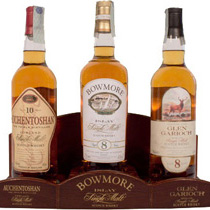 Single+Malt+Set+mit+Display+%2F+Glen+Garioch+8+Jahre%2C+Bowmore+8+Jahre%2C+Auchentoshan+10+Jahre - Yeh thats a must for each bar. A wood display with 3 bottles each contain 700 ml. and 40 % Vol. Its a Auchentoshan 10 years, Bowmore 8 years (very rare in Germany) and a Glen Garioch 8 years.