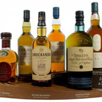 Single Malt Display with Caol Ila, Talisker, Lagavulin, Cardhu, Singleton and Knockando - A Single Malt Display in a great design  One each of the following is included with the stand.  1x Talisker 10 years with 0,7l and 45,8% Vol. 1x Cardhu 12 years with 0,7l and 40% Vol. 1x Caol Ila 12 y...